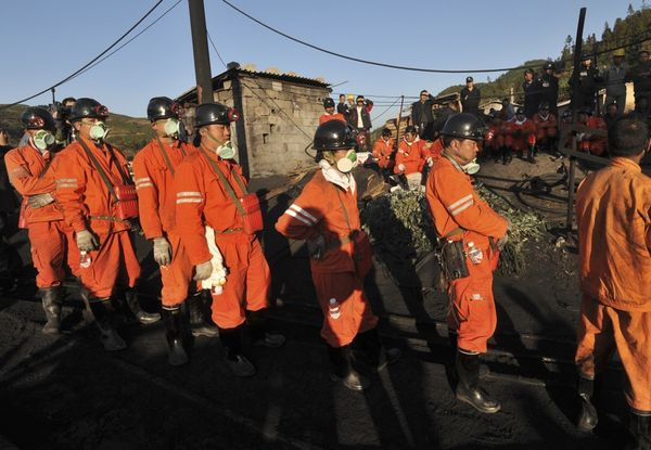 Rescuers at a coal mine after a gas leakage accident, Yunnan province