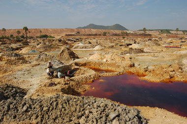 Villagers sifting through toxic mining waste at Ivanhoe's Monywa mine