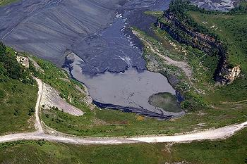 Sludge dam near mountaintop removal coal mining site in Logan County, West Virginia