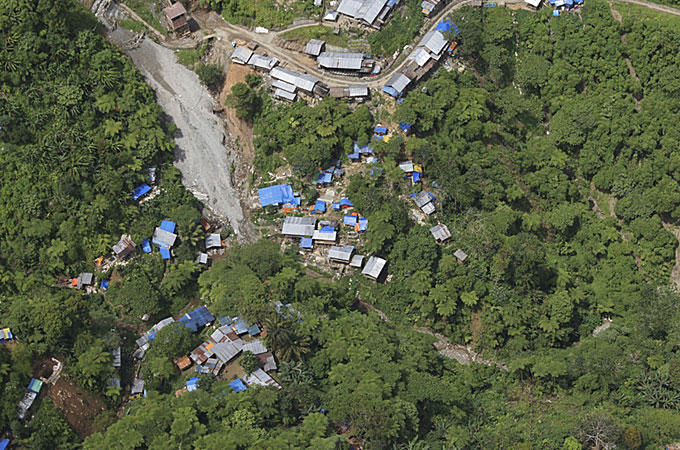 An aerial view of a shanty town buried by a landslide in a mining area in Kingking village of Pantukan town
