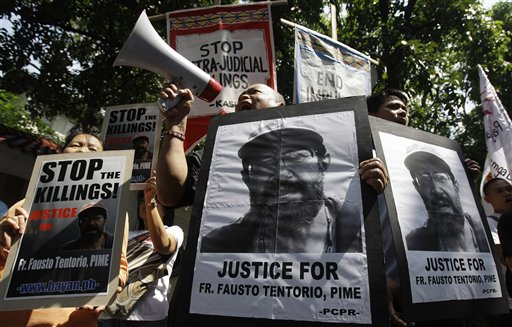 Filipino protests in Manila demanding justice for killing of Italian priest Fausto Tentorio