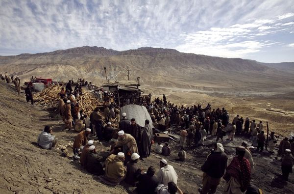 Residents And Rescue Workers Gather At The Entrance Of A Coal Mine In Quetta