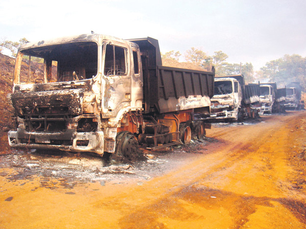 Burnt out trucks after NPA mine raid