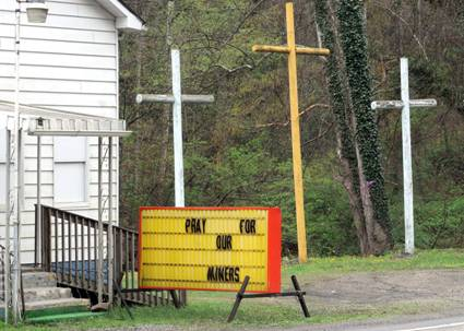 Crosses and sign act as memorial to dead US coal miners