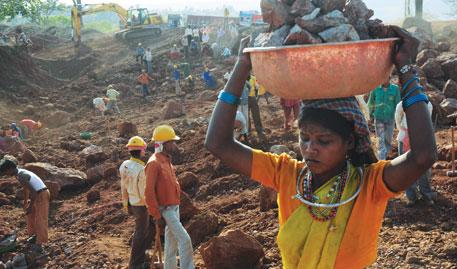 A displaced Baiga woman works as a day labourer at Vedanta's bauxite mine