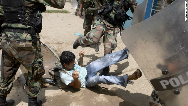 A gold miner clashes with Peruvian riot policemen during protests in the country's Madre de Dios region