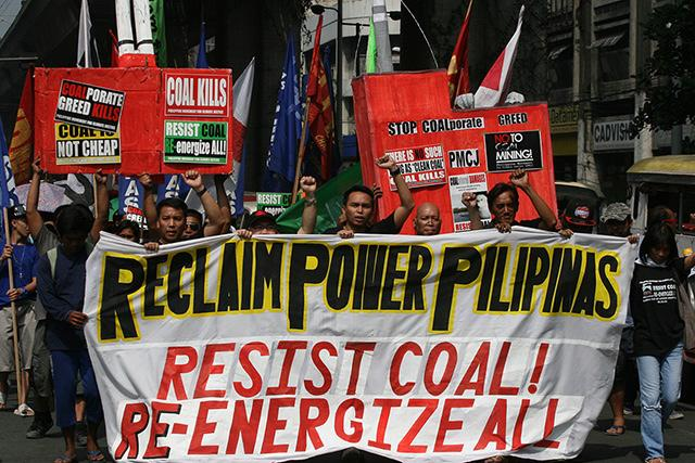 Residents of coal-affected communities march to Mendiola on Tuesday, 22 October 2013