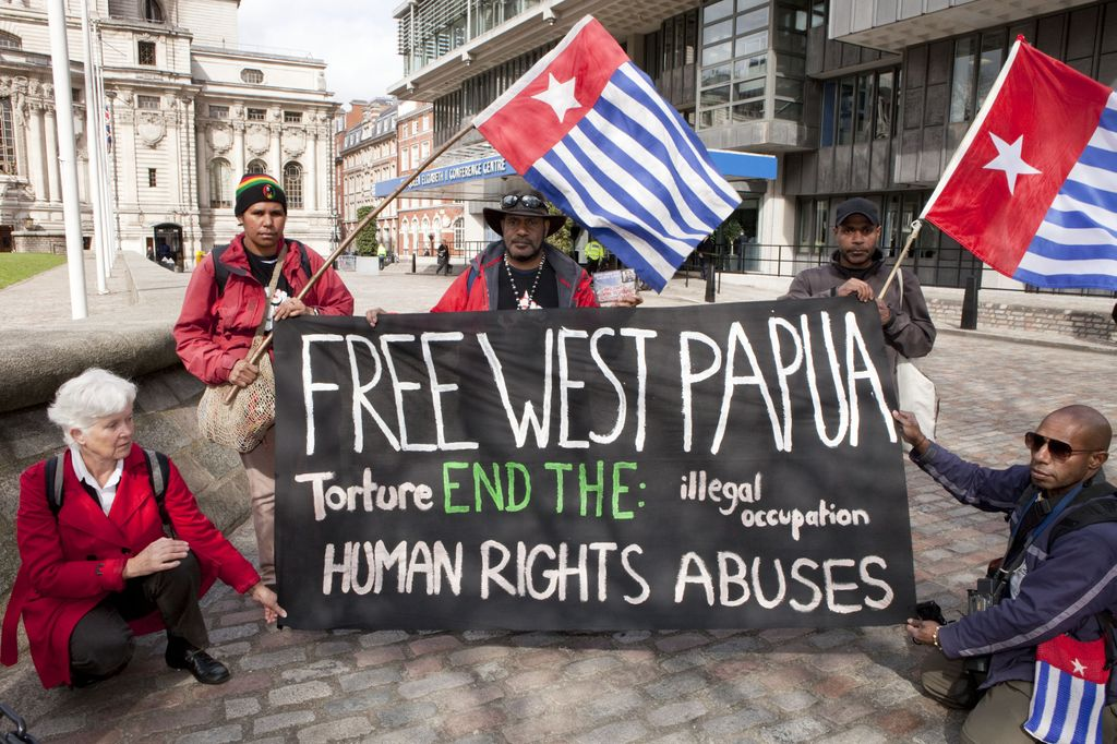 West Papuan activists protest outside Rio Tinto's AGM over the company's involvement in the Grasberg mine. Photo: Amy Scaife