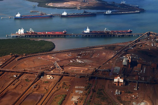 Boats waiting to load iron ore at Port Hedland, Australia